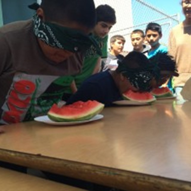 Students are nervous, yet excited to devour a watermelon blindfolded!