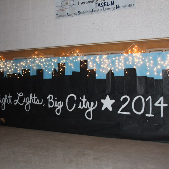 "The 8th grade dance theme is ""Bright Lights, Big City!"""