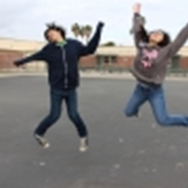 Students jump with excitement after an eventful day in class.